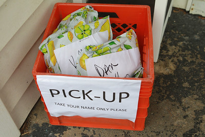 Candace H. Johnson-For Shaw Media A Pick-Up bin for sewers picking up supplies or mailing masks sit in a bin with individual names on them at Anna Haley Fielder's, organizer of the Mask Brigade, home in Antioch. (3/26/20)