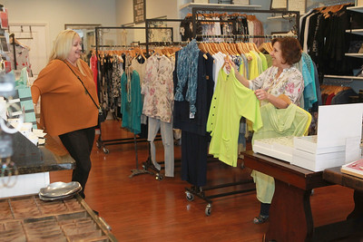 Candace H. Johnson-For Shaw Media Jill Lueders, of Grayslake looks at some suggestions for tops to wear by Bonnie Schulz, owner, at Bonnie's Chic Boutique in Grayslake. Due to Covid-19, the store is open by appointment only. (3/31/20)