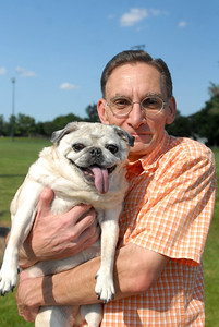Patrick Skach, of Oak Brook, holds Mighty Mouse, a 12-year-old female Pug, at Ty Warner Park in Westmont on Friday, Aug. 16, 2013. Mighty Mouse, who was diagnosed with diabetes 2-years ago, lost her sight as a result of the disease. Matthew Piechalak – mpiechalak@shawmedia.com