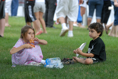 "Autumn Oregon, 6, and her brother, Avery, 4, of Addison enjoy slices of pizza in the grass during the ""By the Slice"" pizza competition, held as part of National Night Out at Friendship Plaza in Addison on Tuesday, Aug. 6, 2013. Matthew Piechalak – mpiechalak@shawmedia.com"