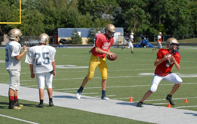 Lemont quarterbacks go through a drill during practice on Tuesday, Aug. 27, 2013. Matthew Piechalak – mpiechalak@shawmedia.com