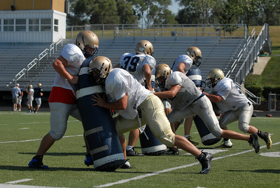 Lemont linemen work on a hitting drill during practice on Tuesday, Aug. 27, 2013. Matthew Piechalak – mpiechalak@shawmedia.com