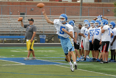 Riverside-Brookfield senior quarterback Jack VandeMerkt throws a pass on-the-run during practice on Thursday, Aug. 15, 2013. Matthew Piechalak –mpiechalak@shawmedia.com