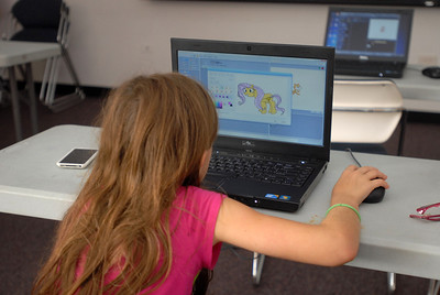 Ten-year-old Kayla Kerr, of Westmont works on a digital drawing during a session of the Video Game Design Club at the Westmont Public Library, 428 N. Cass Ave. in Westmont on Thursday, Aug. 8, 2013. The bi-weekly class utilizes the Massachusetts Institute of Technology's Scratch program, a toolkit that allows children to create interactive art and animated stories. Matthew Piechalak – mpiechalak@shawmedia.com