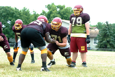Westmont senior center Josh LaCour (No. 71) works on blocking during practice on Thursday, Aug. 22, 2013. (Matthew Piechalak photo)