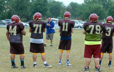 Westmont head coach Otto Zeman talks to his varsity players during practice on Thursday, Aug. 22, 2013. (Matthew Piechalak photo)