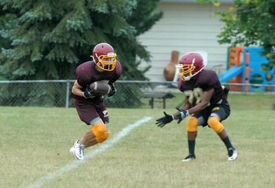 Westmont senior Danny LoGiurato, left, catches a pass during practice on Thursday, Aug. 22, 2013. (Matthew Piechalak photo)
