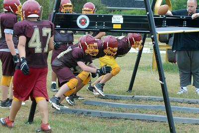 Westmont linemen go through a drill during practice on Thursday, Aug. 22, 2013. (Matthew Piechalak photo)