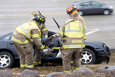 Sarah Sutschek - ssutscheknwhearld.com  Crystal Lake firefighters remove the driver of a Toyota Avalon after a three car crash at the intersection of Three Oaks Road and Route 31 early Thursday morning. The driver of the Avalon was transported to the hospital.