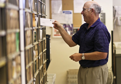 Josh Peckler - Jpeckler@shawmedia.com Dan Guttschow sorts mail at the Hebron Post Office Tuesday, July 31, 2012 on his last day before retiring after 29 years as the Postmaster at the Hebron Post Office.