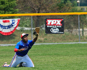 Dbat Mustang's Obi Obinwa goes to his knees to make the catch during the 5th inning of gameplay at Lippold Park on Wednesday. Dbat Mustangs defeated the Crystal Lake Cyclones 16-8