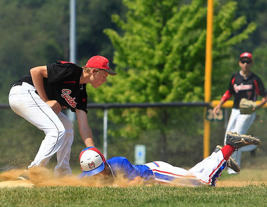 Mustangs Jack Underwood (4) slides past  Cyclones Schingel (44) to take 3rd base during the 1st inning of gameplay at Lippold Park in Crystal Lake on Wednesday. Mustangs defeated the Cyclones 16-8