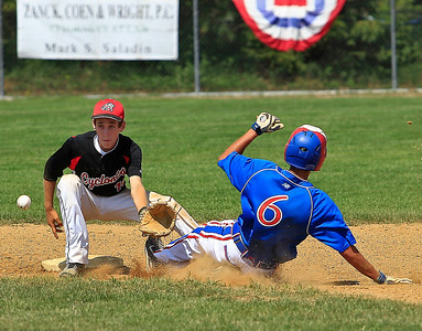 Mustangs AJ Liu  slides past Crystal Lake Cyclone's Baker to steal 2nd base during the second inning of gameplay at Lippold park on Wednesday. DBAT Mustangs defeated the Crystal Lake Cyclones 16-8.