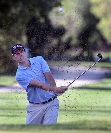 Jeff Krage – For the Kane County Chronicle<br /> Garrett Patten hits out of the bunker during Saturday's semifinal round of the St. Charles Men's Golf Tournament at Pottawatomie Golf Course. <br /> St. Charles 8/11/12
