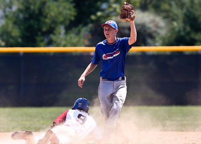 Josh Peckler - Jpeckler@shawmedia.com Mchenry Hurricane shortstop Garrett Bright holds up the ball after tagging out a Puerto Rico Cardenales player during the fourth inning of a MCYSA Summer International Championship game at Petersen Park in Mchenry Friday, August 3, 2012.
