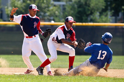 Josh Peckler - Jpeckler@shawmedia.com Mchenry Hurricane's Joe Addante slides into second base while Puerto Rico Cardenale's Heydell Alicea (50) and a teammate attempt to tag him out during the 5th inning of a MCYSA Summer International Championship game at Petersen Park in Mchenry Friday, August 3, 2012.