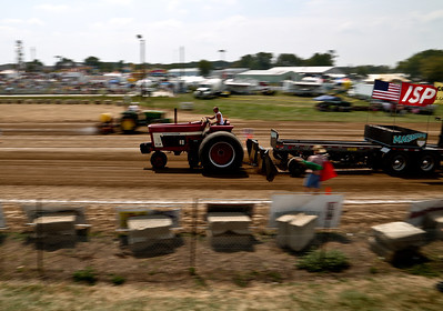 Josh Peckler - Jpeckler@shawmedia.com A competitor in the tracker pull event moves through the course during the Mchenry County Fair in Woodstock Saturday, August 4, 2012.