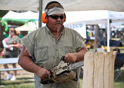 Josh Peckler - Jpeckler@shawmedia.com Don Johnson of Alton uses a chain saw to make wood carvings during the Mchenry County Fair in Woodstock Saturday, August 4, 2012.
