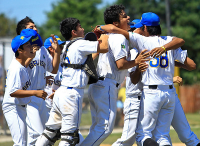Team Brasil celebrates winning the 15U Championship against Japan at Lippold Field on Sunday. Brasil defeated Japan 5-1