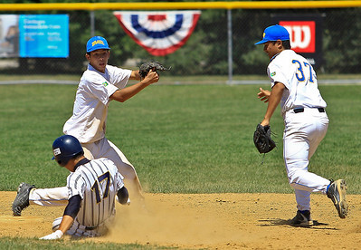 Brasil Shortstop Gustavo Kamhani (left) makes the play at 2nd base during the 6th inning of gameplay of the 15U championship at Lippold Park on Sunday. Nelson Hashizumi with the assist