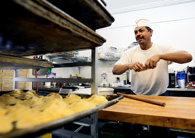 Sarah Nader - snader@shawmedia.com Baker Manuel Yeverino makes mexican cookies while working at the El Molino Azul bakery in Crystal Lake on Tuesday, August 7, 2012. The mexican bakery has been open for the past year and mainly sells to supermarkets in the area but also sells sweets at their retail shop.