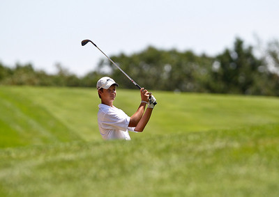 Josh Peckler - Jpeckler@shawmedia.com Billy Walker watches his shot from the fairway on the 1st hole during the McHenry County Junior Golf Association Tournament of Champions at Woodstock Country Club Tuesday, August 7, 2012.