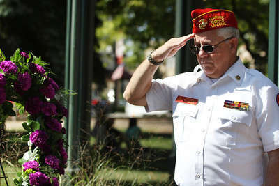 Mike Greene - mgreene@shawmedia.com Jerry Havens, an officer in the McHenry County Marine Corps League Detachment 1009, salutes during a wreath laying ceremony at the state's first Purple Heart Day Tuesday, August 7, 2012 on the Square in Woodstock. The event also included a moment of silence, bell toll, and remarks from local and state legislators in honor of veterans.