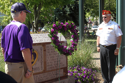 Mike Greene - mgreene@shawmedia.com Veterans stand at attention during a wreath laying ceremony at the state's first Purple Heart Day Tuesday, August 7, 2012 on the Square in Woodstock. The event also included a moment of silence, bell toll, and remarks from local and state legislators in honor of veterans.