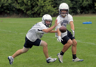 Sarah Nader - snader@shawmedia.com Cary-Grove's Ryan Dundon (left) and Marcus Thimios go for the ball  during opening day of football practice at Cary-Grove High School in Cary on Wednesday, August 8, 2012.