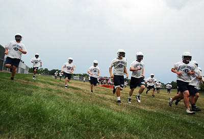 Sarah Nader - snader@shawmedia.com The Cary-Grove football team warms up during the opening day of football practice at Cary-Grove High School in Cary on Wednesday, August 8, 2012.