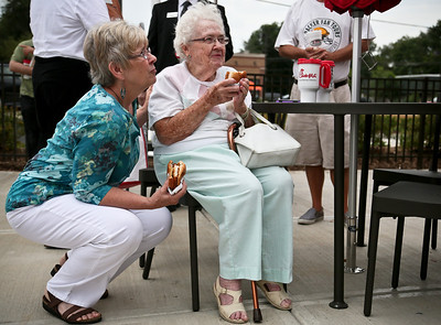Josh Peckler - Jpeckler@shawmedia.com Pam Moore of Hampshire (left) and Shirley Sherman of Dundee and enjoy chicken sandwiches during a grand opening ceremony for Chick-fil-A in Crystal Lake Thursday, August 9, 2012. Moore and Sherman who are the mother and grandmother of owner Ben Moore came out to support the grand opening of his new Chick-fil-A restaurant in Crystal Lake.