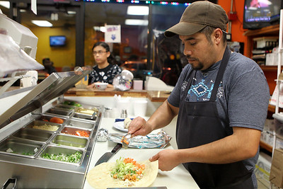 Mike Greene - mgreene@shawmedia.com Samuel Ruiz works on an order Thursday, August 9, 2012 at FasTaco in Woodstock. FasTaco, a family-run mexican restaurant, is one of a number of late night options for those looking to grab a bite after dark.