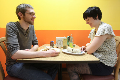 Mike Greene - mgreene@shawmedia.com Woodstock residents Erik Meyers and Jessica Edwards laugh while eating Thursday, August 9, 2012 at FasTaco in Woodstock. FasTaco, a family-run mexican restaurant, is one of a number of late night options for those looking to grab a bite after dark.