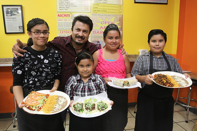 Mike Greene - mgreene@shawmedia.com Alondra, Sulema, Vanessa, and Hector Jr. pose with their father and FasTaco owner Hector Ruiz Thursday, August 9, 2012 at FasTaco in Woodstock. FasTaco, a family-run mexican restaurant, is one of a number of late night options for those looking to grab a bite after dark.