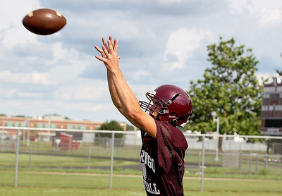 Sarah Nader - snader@shawmedia.com Marengo's Jesse Henning watches a pass during the first week of football practice at Marengo High School on Friday, August 10, 2012.