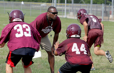 Sarah Nader - snader@shawmedia.com Marengo's head coach Matthew Lynch watches the football team do drills during the first week of football practice in Marengo on Friday, August 10, 2012.