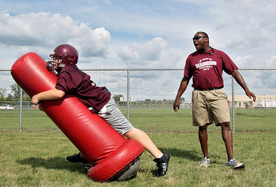Sarah Nader - snader@shawmedia.com Marengo's head coach Matthew Lynch watches freshmen Ben Mussell  do a drill during the first week of football practice in Marengo on Friday, August 10, 2012.