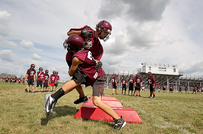 Sarah Nader - snader@shawmedia.com Marengo's Dillon Csanda and Nick Simons tackle each during football practice at Marengo High School on Friday, August 10, 2012.