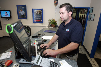 H. Rick Bamman - hbamman@shawmedia.com Existing MAACO business owners opened new AAMCO Transmissions and Total Car Care in Crystal Lake next door to MAACO. Tim Erwin and his father in law Ed Wristen opened the MAACO in Crystal Lake. Mechanic  Brian Bove goes through a check list while servicing a vehicle. MAACO Manager Dave Kramer fine sands the nose cover of a jet ski. Sean Borscha working in the painting booth. Jeff Freund tapes a vehicle before painting. Service Manager Justin Cassiano.
