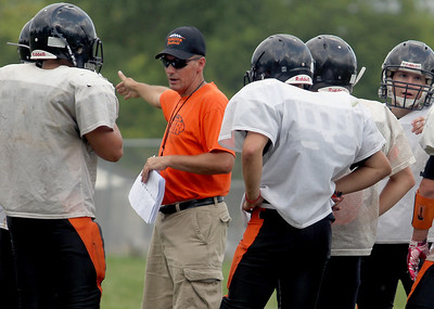Sarah Nader - snader@shawmedia.com McHenry head coach Dave D'Angelo talks with the football team during football practice in McHenry on Tuesday, August 14, 2012.