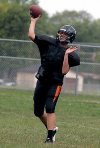 Sarah Nader - snader@shawmedia.com McHenry's Michael Briscoe throws a pass to a teammate during football practice in McHenry on Tuesday, August 14, 2012.