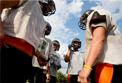Sarah Nader - snader@shawmedia.com Members of the McHenry football team huddle up during football practice in McHenry on Tuesday, August 14, 2012.