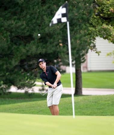 Batavia's Nathan Podraza chips onto the green during the Geneva Invitational Boys Golf Tournament at Mill Creek Golf Club in Geneva Thursday.