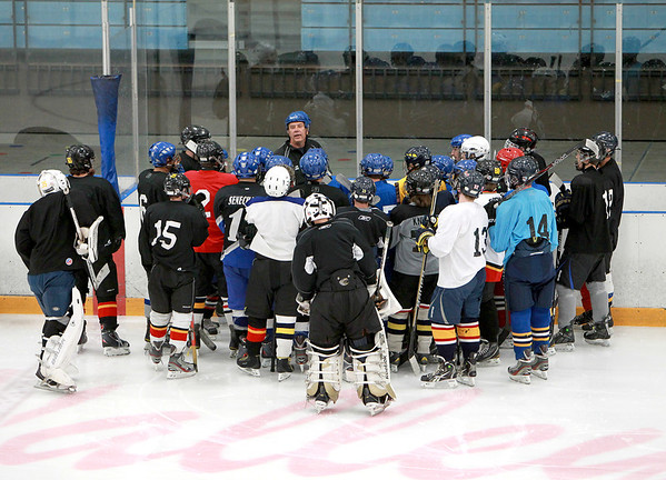Coach Jim Quinn talks to his team during the first practice with the Fox Valley Hawks hockey club at Fox Valley Ice Arena in Geneva Monday night.