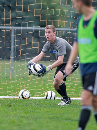 St. Charles North goalkeeper Billy Larsen practices with the team Wednesday morning.