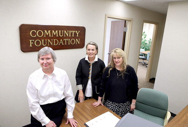 (From left) Sharon Stredde, president and CEO of The Community Foundation of the Fox River Valley, Jane Harris, foundation board member, and Rhonda Soos, executive assistant, pose for a photo in their Aurora offices. The Community Foundation of the Fox River Valley administers 394 funds or scholarships, including a recently created fund in honor of Mary Bencini.