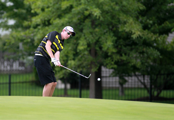 Kaneland golfer Sean Glennon practices at Mill Creek Golf Course in Geneva Tuesday afternoon.