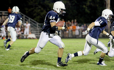 Sarah Nader - snader@shawmedia.com Cary-Grove's Kyle Norberg runs down field during the second quarter of Friday's game against St. Charles East in Cary on August 24, 2012. Cary-Grove won, 49-33.