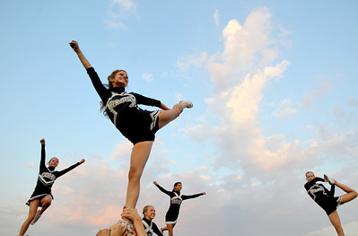 Sarah Nader - snader@shawmedia.com Cary-Grove cheerleader Maddie Hall (center) 16, of Cary performs a cheer before Friday's football game against St. Charles East in Cary on August 24, 2012.
