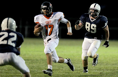 Sarah Nader - snader@shawmedia.com St. Charles East's quarterback (# 17) carries the ball down field during the second quarter of Friday's game against Cary-Grove in Cary on August 24, 2012.